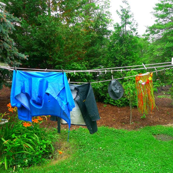 And notice the hula skirt hanging next to the fireman's jacket on the clothesline.