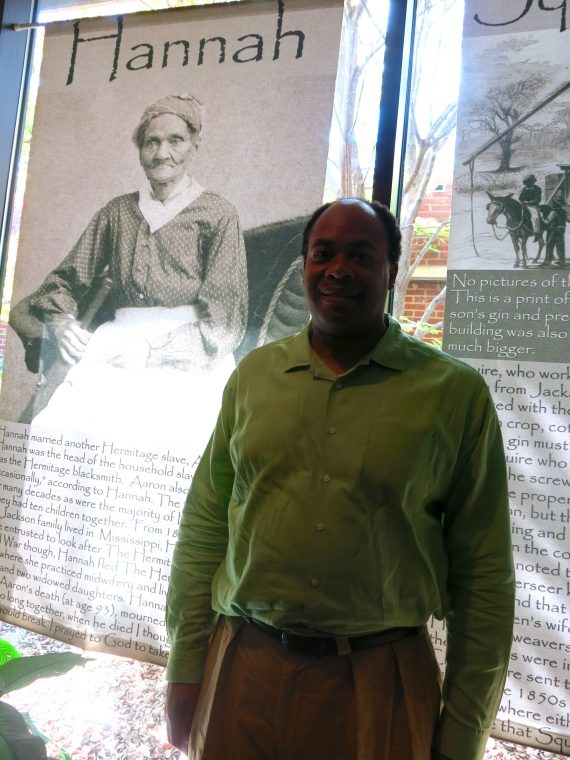 David Ewing standing in front of another of his ancestors, Hannah.