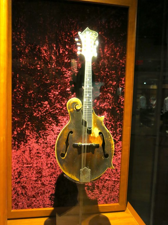 There were a lot of guitars. They ranged from the most humble to the most ornate. They ranged from fiddles to acoustic guitars. This is Bill Monroe's Gibson F-5 Mandolin. Considered the most famous mandolin in American history.