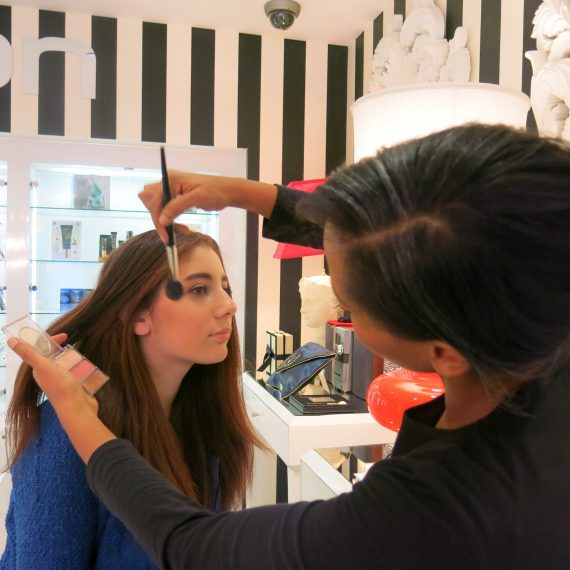 Lucy getting the Hollywood glam look. We both left wearing flash eyelashes. We thought  we looked very cool.