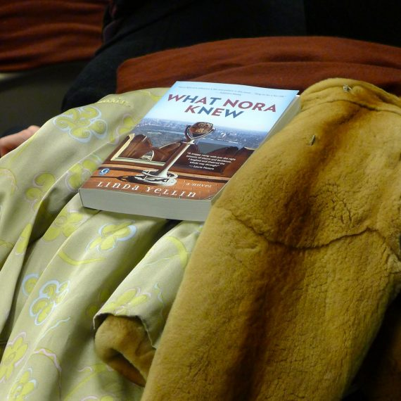 Book tucked into a coat waiting to go home and be loved.