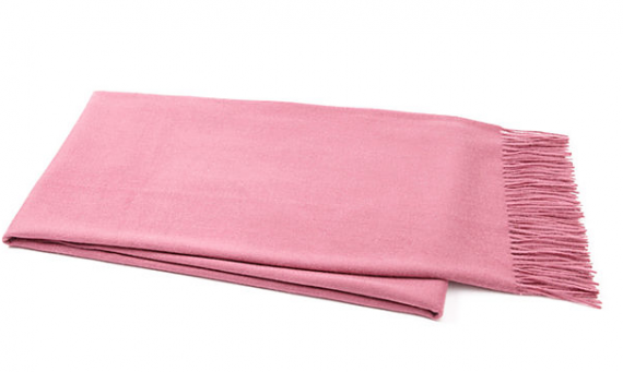 Spring up a room with a pink throw. You can use it as a shawl as well. Garnet Hill.