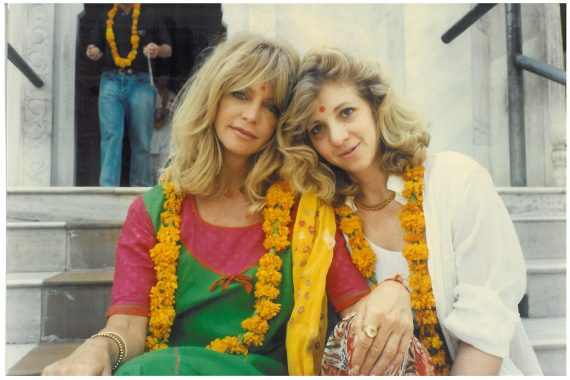 """We were in front of a Ganesh Temple. We had been to the ladies room and the woman who lived in the house behind the temple who was about 100, had taken our faces in her hands and said """"Be happy."""" At which point we both broke into tear. We did. It was magic. This woman has something godly about her. You can see it in our faces in this shot. Total peace."""