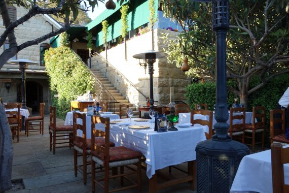 The green hued outdoor dining room at the San Ysidro Ranch