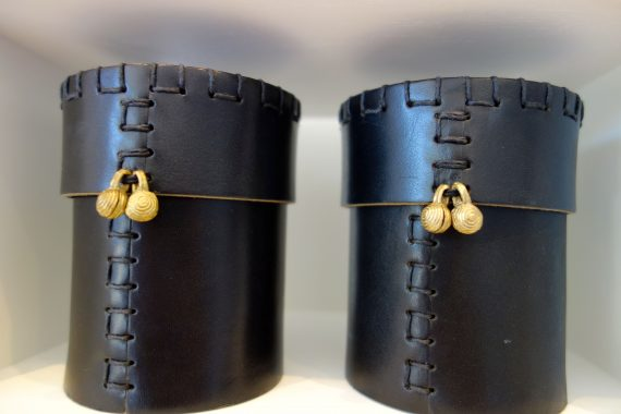 You know a designer is getting hot when they have their own candles. I love these in their leather holders.