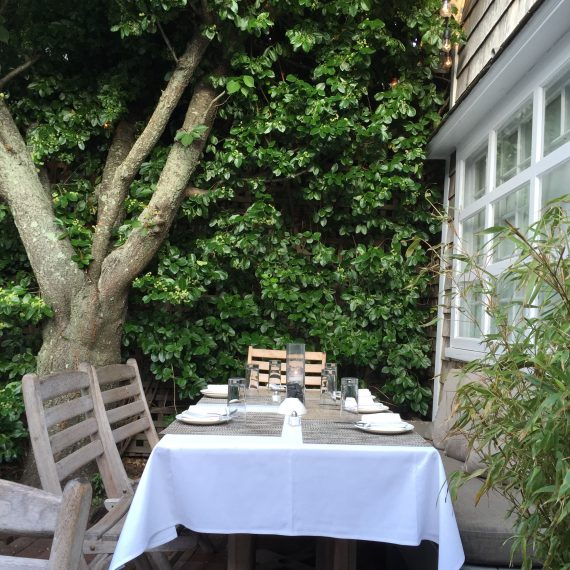 Eating out doors in a quiet setting.  This is Tutto Il Giorno in Sag Harbor.
