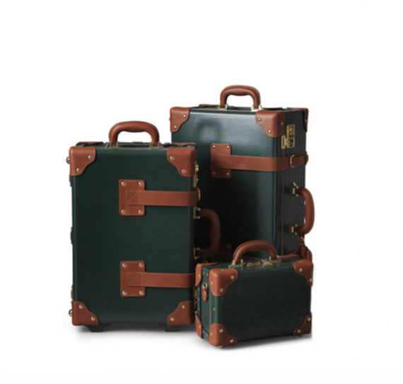 A set of hunter green luggage. It will remind of Christmas overtime someone uses it.