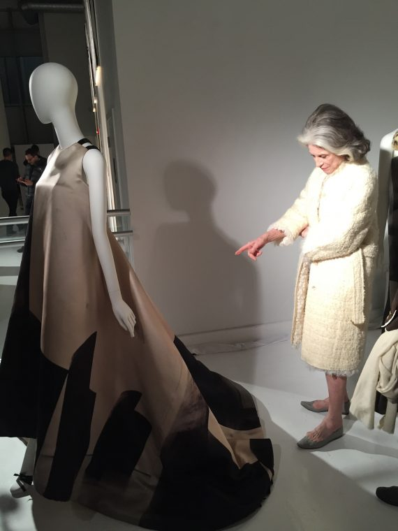 Longtime Rucci client Deeda Blair examines the clothes.