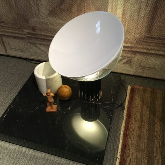 This lamp is on my things to add to my collection. It's the Achille& Pier Giacomo Castigloni Taccia table lamp. In production but you want an old one.