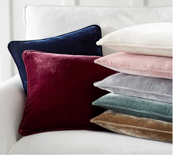 Velvet Throw Pillows a little plushness for not a lot of money. Not a bad way to go. Pottery Barn.